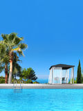 Swimming pool, palms, cypress and pavilion. Fictitious 3D rendering showing a swimming pool with pavilion, palms and cypress Stock Photo