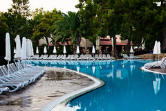 Swimming pool and palms in hotel Stock Image