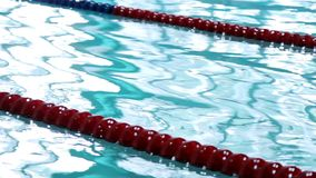 Swimming pool paths. Clear water in swimming pool with race lanes. Empty pathes in swimming pool stock video footage