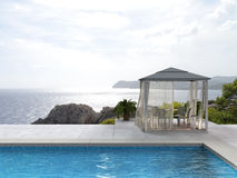 Swimming pool, pavilion and the sea. Pavilion by the pool with a view to the sea - fictitious 3D rendering Stock Image