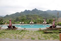 Beautiful landscape with nice swimming pool beside the mountain royalty free stock photo