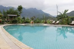 Beautiful landscape with nice swimming pool beside the mountain stock photos