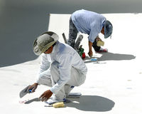 Swimming Pool Plasterers Stock Photo