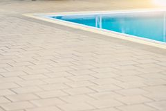 Swimming pool and pool edge for sport. Swimming pool and pool edge with sunset. Concept sport outdoor for exercise Stock Photos