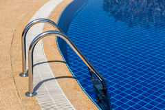 Swimming pool with pool ladder in hotel Stock Images