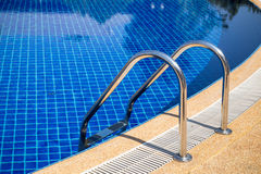 Swimming pool with pool ladder in hotel Royalty Free Stock Photos