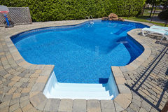 Swimming pool. Private swimming pool with a blue clear water Stock Photo