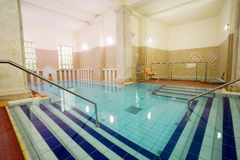 Swimming pool in the public baths Stock Images