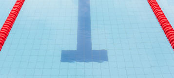 The swimming pool with red marked lanes for swimming competition Stock Images