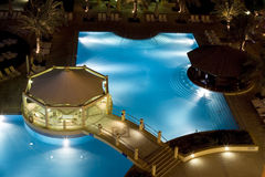 Swimming pool and relax. Night view of a big blue swimming pool Stock Images