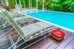 Swimming pool with relaxing seats . Stock Photo