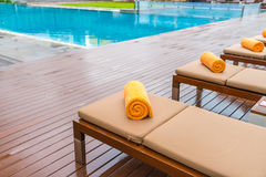 Swimming pool with relaxing seats . Royalty Free Stock Photo