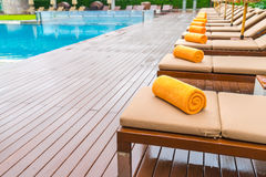 Swimming pool with relaxing seats . Stock Images