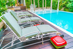 Swimming pool with relaxing seats . Stock Photos