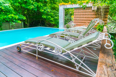 Swimming pool with relaxing seats . Stock Photography