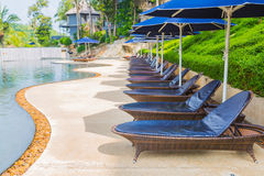 Swimming pool with relaxing seats background royalty free stock photos
