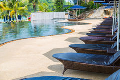 Swimming pool with relaxing seats Stock Photography