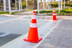 Swimming pool repair - safety cone on edge.  Royalty Free Stock Image