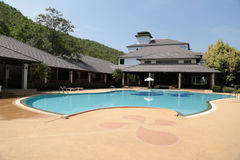 Swimming pool in resort. With blue sky royalty free stock images