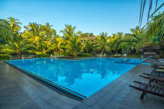 Swimming pool in resort at outdoors Royalty Free Stock Images