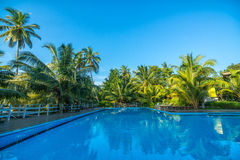 Swimming pool in resort at outdoors Royalty Free Stock Photography
