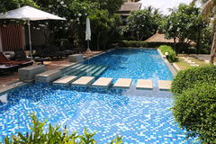 Swimming pool at the resort of thailand. Outdoor swimming pool of the pranburi resort of thailand Royalty Free Stock Images