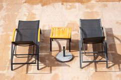 Swimming pool rest chairs  Stock Photos