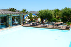The swimming pool and restaurant's terrace at luxury hotel Stock Photography