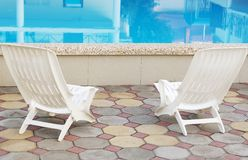 Swimming pool and resting chairs Royalty Free Stock Image