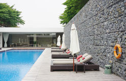 Swimming pool with rock wall Royalty Free Stock Image