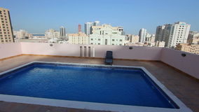 Swimming pool at roof of apartment in bahrain stock footage
