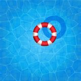 Swimming pool with rubber ring floating on it Royalty Free Stock Photography