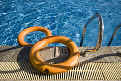 A swimming pool and a rubber safety ring Royalty Free Stock Photography