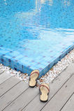Swimming pool and sandals Royalty Free Stock Photos