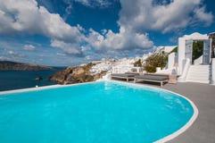 Swimming pool in Santorini Stock Photo
