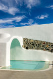 Swimming pool at Santorini island Stock Photo