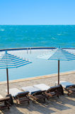 Swimming pool by sea Stock Photography
