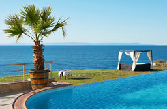 Swimming pool and sea Royalty Free Stock Images