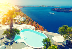 Swimming pool with sea and mountain view on coast of Fira town Santorini, Greece Stock Photography