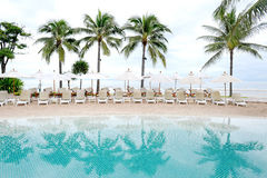 Swimming pool by sea at resort hotel Stock Images