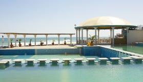 Swimming pool on sea shore Royalty Free Stock Image