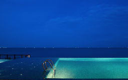 Swimming pool and sea. Swimming pool,the sea and the star in the night Stock Images