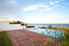 Swimming pool with sea view Royalty Free Stock Photos
