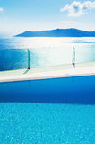 Swimming pool with sea view Stock Photos