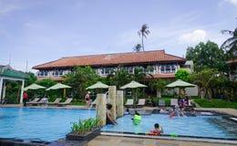 Swimming pool at seaside hotel in Vietnam. Phan Thiet, Vietnam - Mar 26, 2017. People enjoy at swimming pool in Phan Thiet, Vietnam. Phan Thiet belongs to Binh Stock Photos