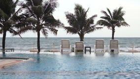 Swimming pool seaside of luxury hotel. Stock Photos