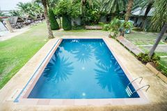 Swimming pool in a seaside tropical resort for holidays Stock Images