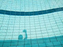 Swimming pool shadow Stock Images