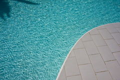 Swimming pool and shadows Royalty Free Stock Photo