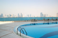 Swimming pool with Sharjah fountain view Royalty Free Stock Photos